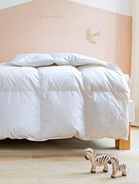 Couette Le Petit Cosme, recouvrant un lit